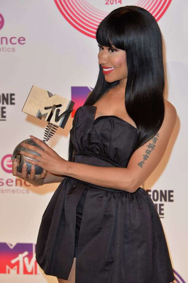 Nicki Minaj is both host and nominee as Scotland lends a tartan touch to the MTV Europe Music Awards.  Here she poses backstage with her Best Hip Hop trophy during the MTV EMA's 2014 at The Hydro on November 9, 2014 in Glasgow, Scotland. Photo: Anthony Harvey, Getty Images For MTV / 2014 Getty Images