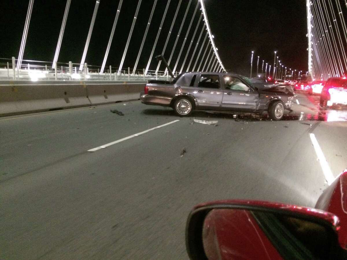 A driver took pictures of a head-on wreck Saturday night on the Bay Bridge that injured three and snarled traffic for hours.