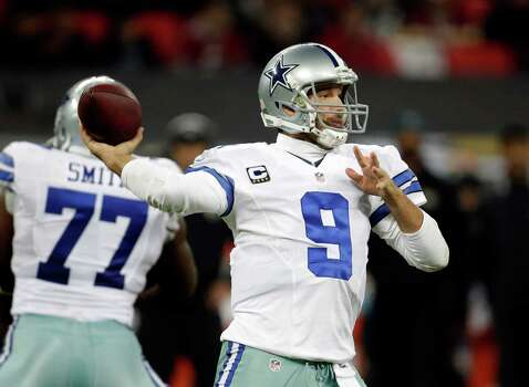 Dallas Cowboys quarterback Tony Romo (9) passes the ball against the Jacksonville Jaguars during the first half of an NFL football game at Wembley Stadium, London, Sunday, Nov. 9, 2014.  (AP Photo/Matt Dunham) Photo: Matt Dunham, Associated Press / AP