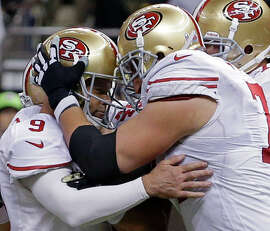 San Francisco 49ers kicker Phil Dawson (9) is congratulated by tackle Joe Staley (74) after kicking the game winning field goal in overtime of an NFL football game against the New Orleans Saints in New Orleans, Sunday, Nov. 9, 2014. The San Francisco 49ers won 27-24. (AP Photo/Jonathan Bachman)