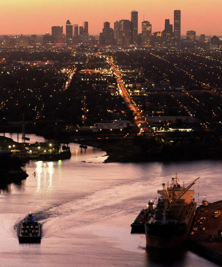 The Houston skyline is seen behind traffic on the Ship Channel in January. The Houston Ship Channel will be rededicated in a ceremony today to celebrate its centennial. Photo: Smiley N. Pool, Staff / © 2014  Houston Chronicle