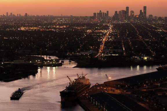 The Houston skyline is seen behind traffic on the ship channel in an aerial view on Monday, Jan. 20, 2014, in Houston. ( Smiley N. Pool / Houston Chronicle )