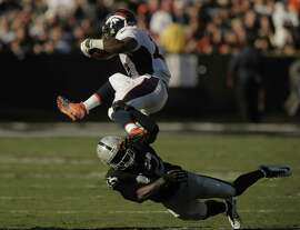 Oakland's Larry Asante (42) can't get a hand on CJ Anderson (22) in the second half of the Raiders game on Sunday. The Oakland Raiders played the Denver Broncos at O.co Coliseum in Oakland, Calif,. on Sunday, November 9, 2014.