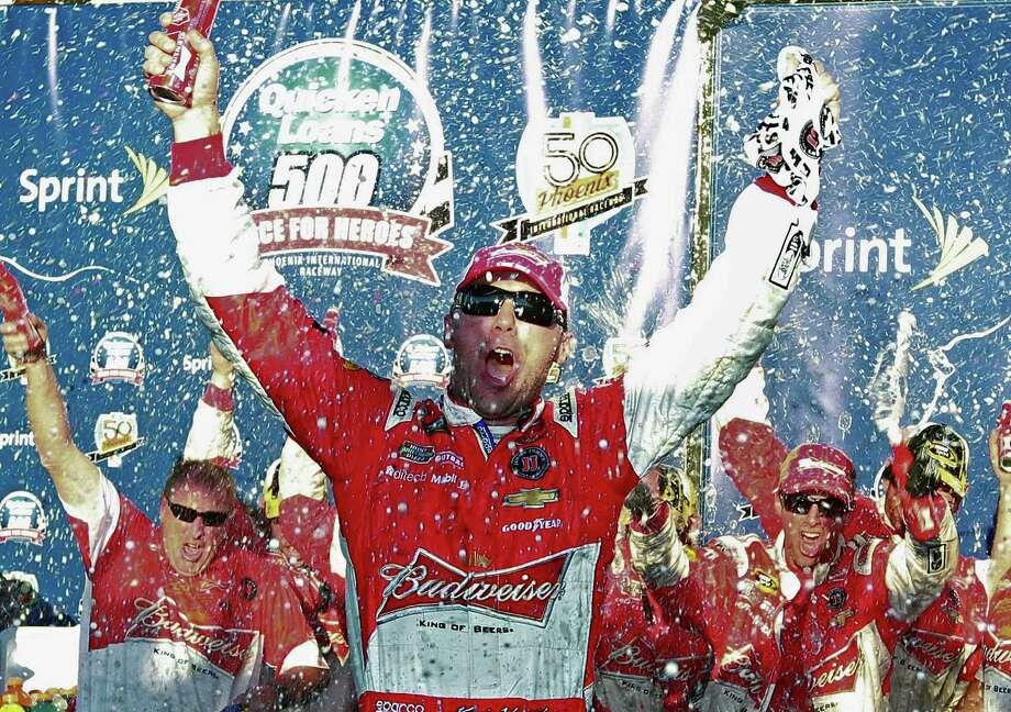 Kevin Harvick celebrates in Victory Lane after winning the NASCAR Sprint Cup series auto race at Phoenix International Raceway, Sunday, Nov. 9, 2014, in Avondale, Ariz. (AP Photo/Ralph Freso) ORG XMIT: AZRF216 Photo: Ralph Freso / FR170363 AP