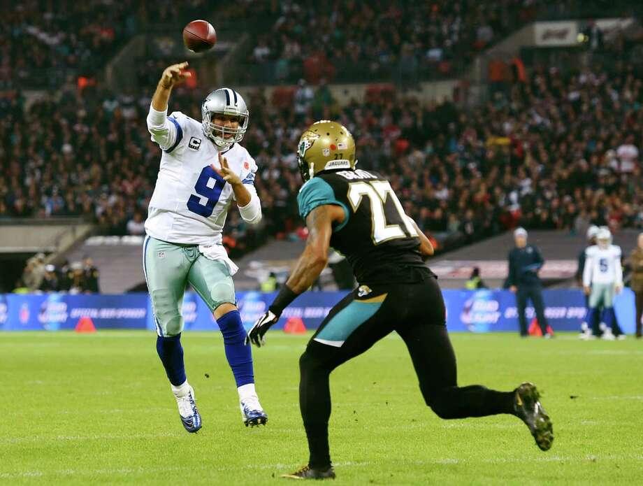 Cowboys quarterback Tony Romo, throwing over the Jaguars' Dwayne Gratz, felt good enough to finish with a season-best passer rating of 138.8. Photo: Tim Ireland, FRE / FR171237 AP
