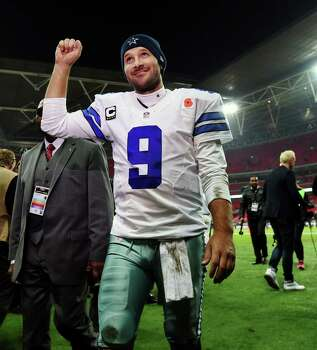Cowboys QB Tony Romo acknowledges the Wembley Stadium crowd after beating the Jaguars in London. Romo was 20 of 27 for 246 yards with three touchdowns in his first action since being sidelined with back trouble. Photo: Tim Ireland / Tim Ireland / Associated Press / AP