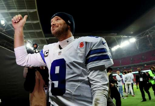 Cowboys quarterback Tony Romo gives a thumbs up after their 31-17 victory over the Jacksonville Jaguars at Wembley Stadium in London. Photo: Tim Ireland, STR / Associated Press / AP