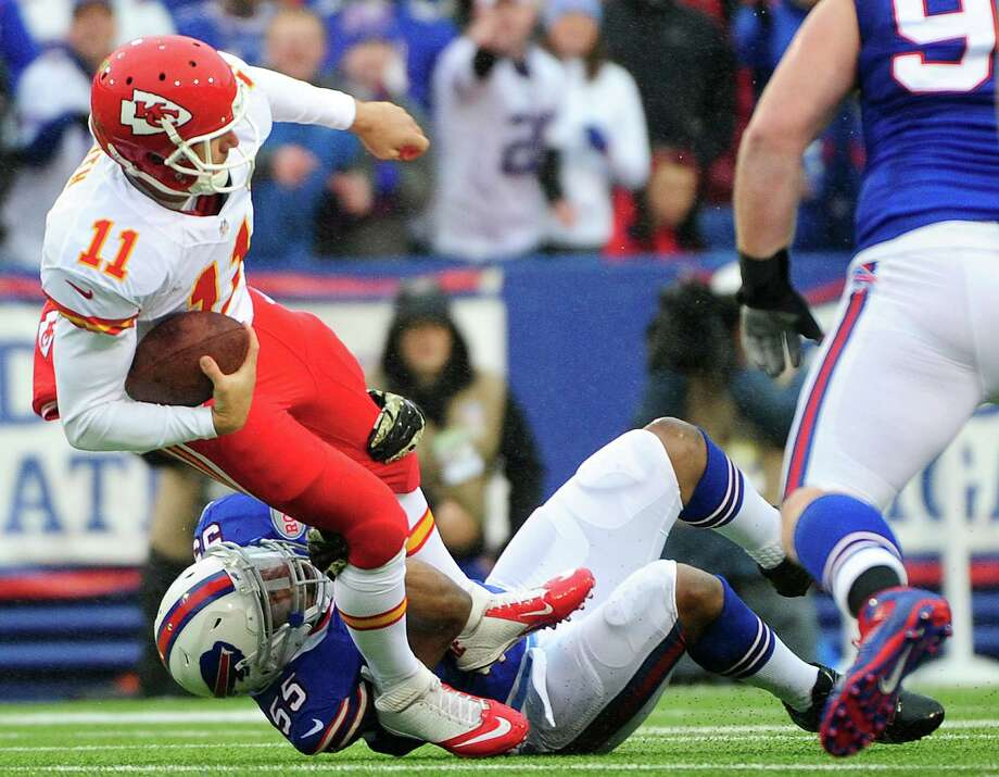 Kansas City Chiefs quarterback Alex Smith (11) is tackled by Buffalo Bills defensive end Jerry Hughes (55) during the first half of an NFL football game, Sunday, Nov. 9, 2014, in Orchard Park, N.Y. (AP Photo/Gary Wiepert) ORG XMIT: NYJC112 Photo: Gary Wiepert / FR170498 AP