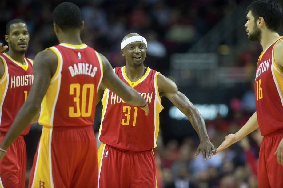 The Rockets are counting on 11-year veteran Trevor Ariza, left, and Jason Terry, center, in his 16th season, to be stabilizing influences despite being newcomers. Photo: Cody Duty, Staff / © 2014 Houston Chronicle