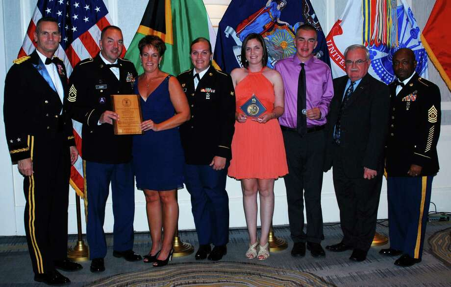 Army National Guard Sgt. Major Timothy Casey, second from left, his Colleen Casey hold the Volunteer Family of the Year Award. Others are Maj. Gen. Patrick Murphy, from left, Spc. Chanleigh Casey, Kayla Casey, Lucas Casey; AUSA rep Dick Smith; and Command Sgt. Maj. Louis Wilson. Division of Military and Naval Affairs