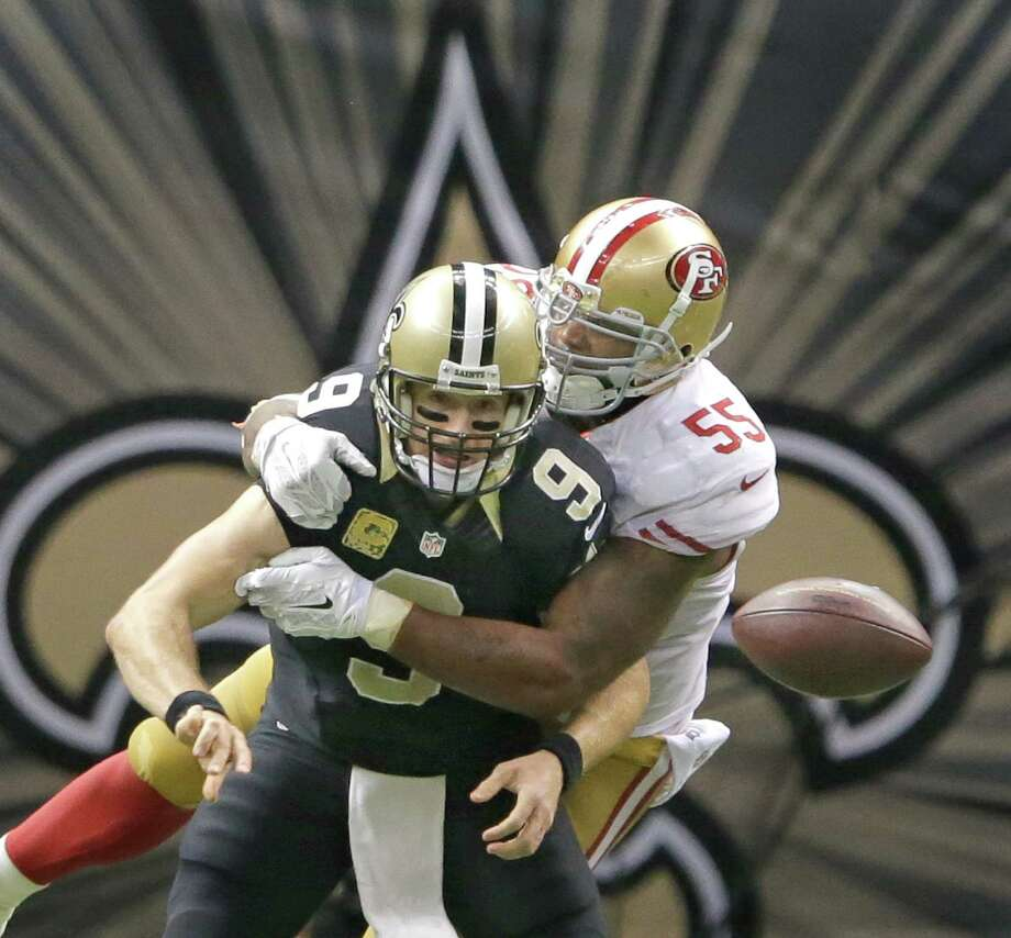 San Francisco's Ahmad Brooks sacks New Orleans' Drew Brees with five minutes left in overtime Sunday at the Superdome. The play, on which Brees lost the ball, set up a 35-yard field goal by Phil Dawson that lifted the 49ers to victory. Photo: David Grunfeld, MBR / NOLA.com The Times-Picayune