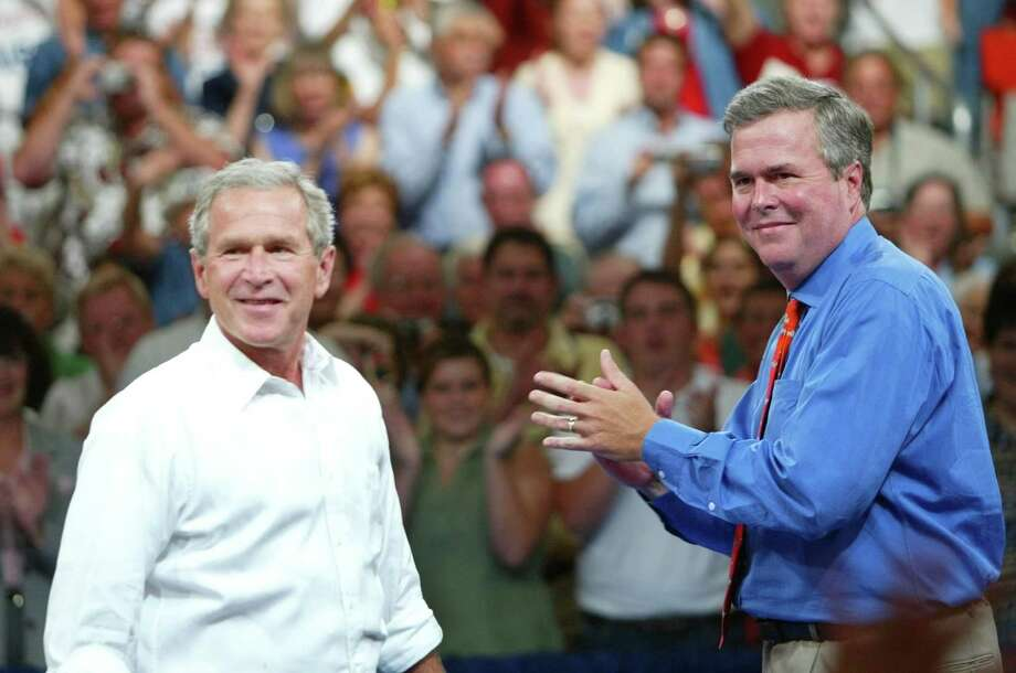 """FILE - In this Aug. 10, 2004 file photo, President George W. Bush, left, is introduced by his brother Florida Gov. Jeb Bush, right, at  'Ask President Bush' campaign rally, at Okaloosa-Walton Community College Gymnasium in Niceville, Fla. President George W. Bush is giving even odds to an attempt at a family legacy as part of the 2016 White House campaign, saying Sunday Nov. 9, 2014 on """"Face the Nation"""" on CBS his brother Jeb Bush is """"wrestling with the decision.""""  (AP Photo/Pablo Martinez Monsivais, File) Photo: Pablo Martinez Monsivais, STF / AP"""