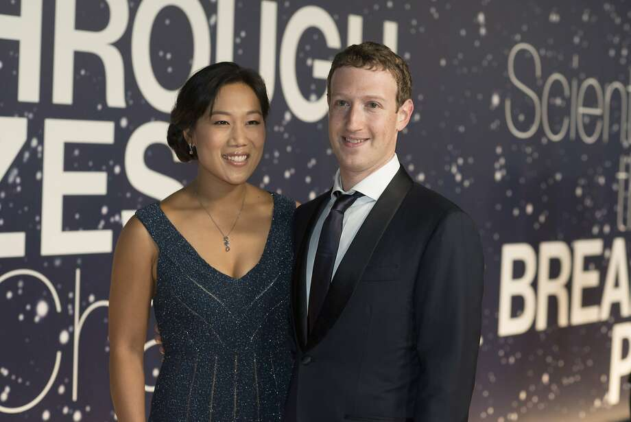 Priscilla Chan and Mark Zuckerberg arrive at the 2nd Annual Breakthrough Prize Award Ceremony at the NASA Ames Research Center on Sunday, Nov. 9, 2014 in Mountain View, California. (Photo by [Peter Barreras]/Invision/AP) Photo: Peter Barreras, Associated Press