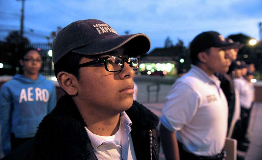 Jose Lliguizaca, 14, of Danbury, stands ready for inspection during a Danbury Police Explorers meeting, Thursday night, October 23, 2014, at the Danbury, Conn, Police Department. Photo: H John Voorhees III / The News-Times Staff Photographer