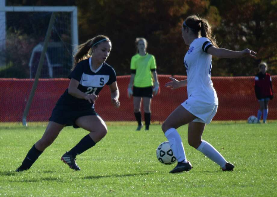 Staples defender Addy Fowle, left, looks to win the ball from a Glastonbury player in the teams' Class LL quarterfinal on Saturday. Glastonbury won 2-1. Photo: Contributed Photo / Westport News Contributed