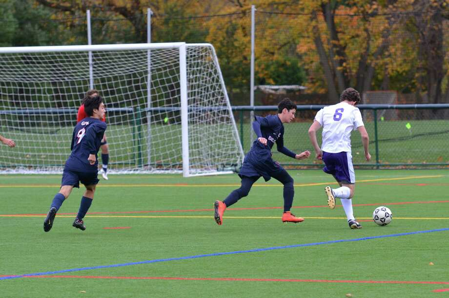 From left: GFA's Matt Allen and sophomore Hobi Lew track down a Masters forward during their FAA final game on Friday, Nov. 7. Masters scored in the final minutes of the game for the win Photo: Contributed Photo / Westport News Contributed