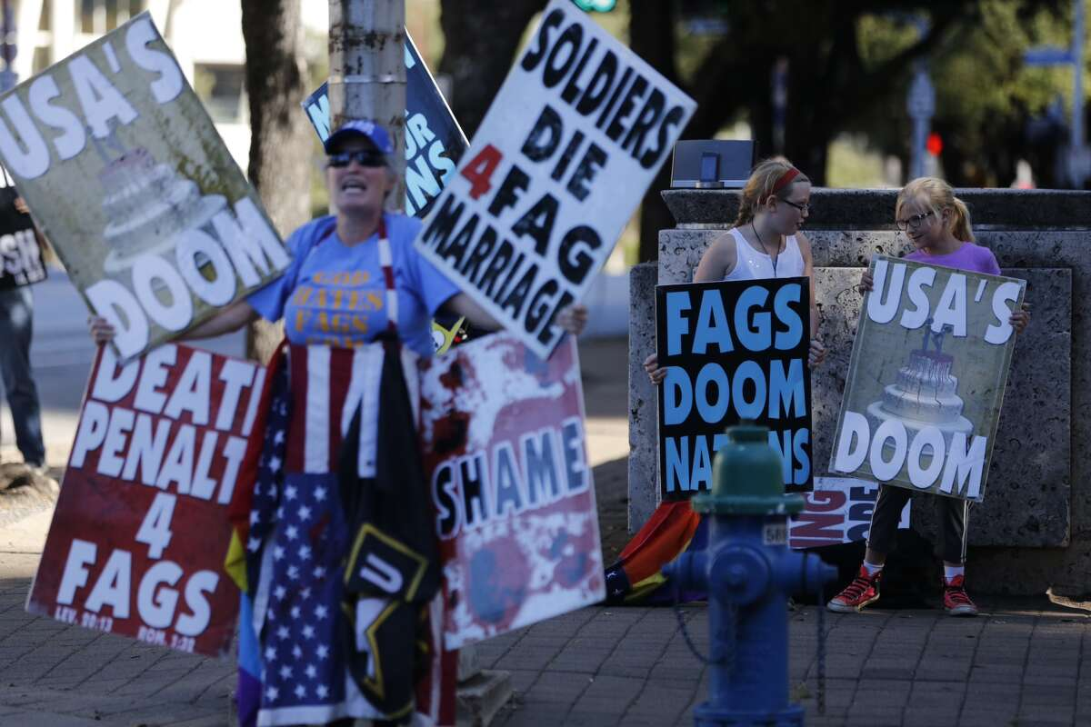 Universalists and members of the Westboro Baptist Church held dueling protests of the city's Equal Rights Ordinance outside of City Hall in Downtown Houston, Monday, Nov. 10, 2014. (Johnny Hanson / Houston Chronicle)