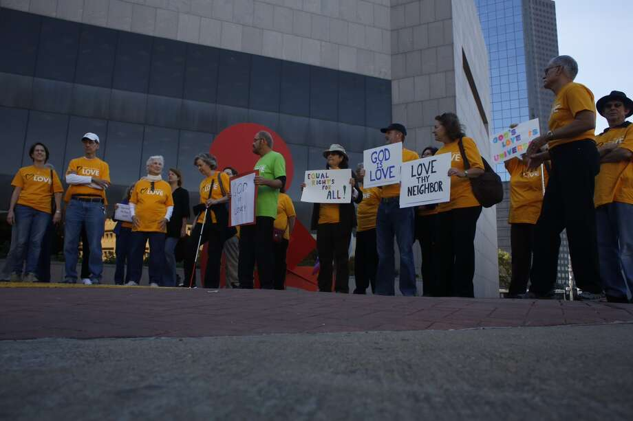 Universalists and members of the Westboro Baptist Church held dueling protests of the city's Equal Rights Ordinance outside of City Hall in Downtown Houston, Monday, Nov. 10, 2014. (Johnny Hanson / Houston Chronicle) Photo: Johnny Hanson / Houston Chronicle