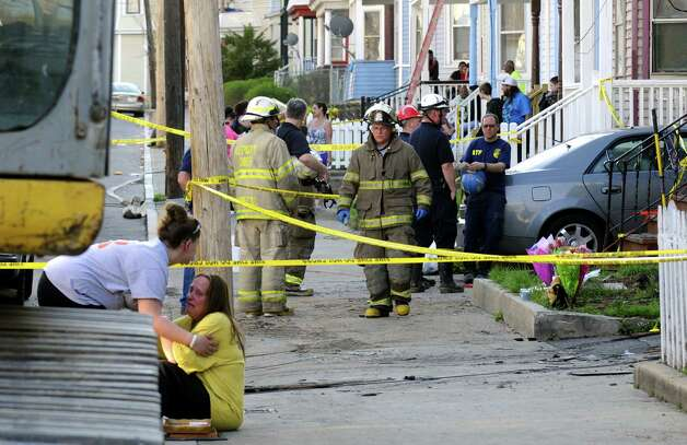 Fire investigators work the scene of a fatal fire at 438 Hulett Street on Thursday May 2, 2013 in Schenectady, N.Y. (Michael P. Farrell/Times Union) Photo: Michael P. Farrell / 10022261A
