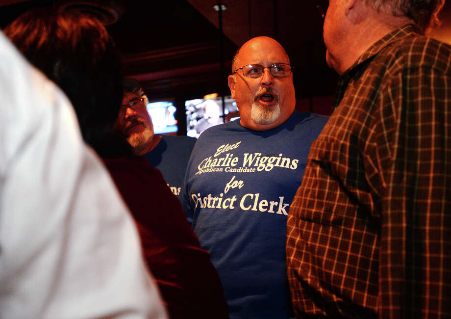 District clerk candidate Charlie Wiggins talks with supporters at Madison's on Tuesday night. Beaumont Republican party candidates held watch parties at Madison's, Tradewinds, and Carlito's on Tuesday evening. Photo taken Tuesday 11/4/14 Jake Daniels/@JakeD_in_SETX Photo: Jake Daniels / ©2014 The Beaumont Enterprise/Jake Daniels