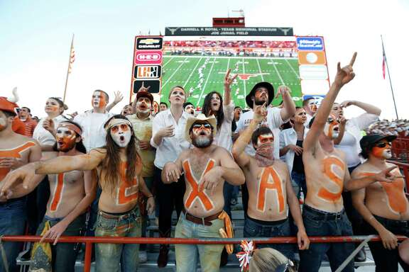 "AUSTIN, TX - NOVEMBER 8: The ""Hellraiser"" student cheering section prepare for the kickoff in the NCAA Big 12 game between the Texas Longhorns and the West Virginia Mountaineers on November 8, 2014 at Darrell K. Royal-Texas Memorial Stadium in Austin, Texas."