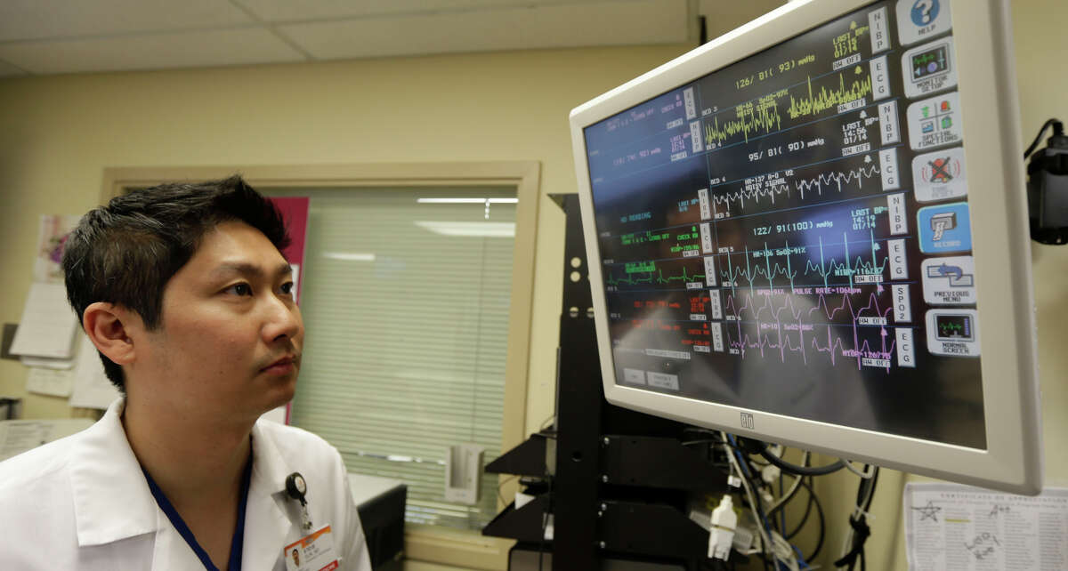 In this Monday, Jan. 14, 2013 photo, Dr. Steve Sun looks over a heart monitor display in the emergency room at St. Mary's Medical Center in San Francisco.