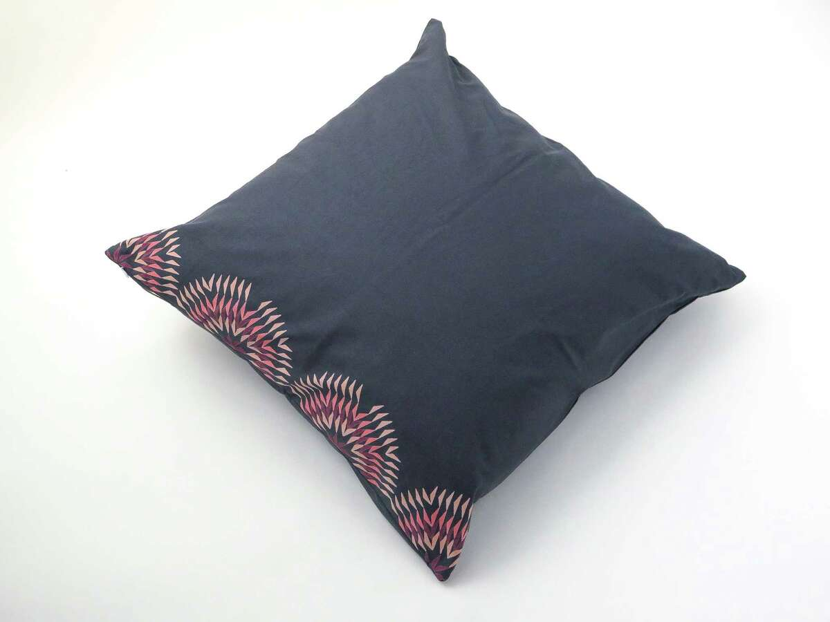Throw pillows from the Erica Tanov and Lena Wolff collaboration, featuring Wolff's dahlia print artwork.