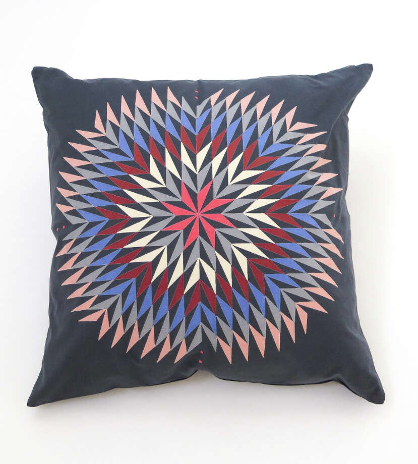 Throw pillows from the Erica Tanov and Lena Wolff collaboration, featuring Wolff's dahlia print artwork. Dahlia print pillow, $126. Photo: Erica Tanov / ONLINE_YES
