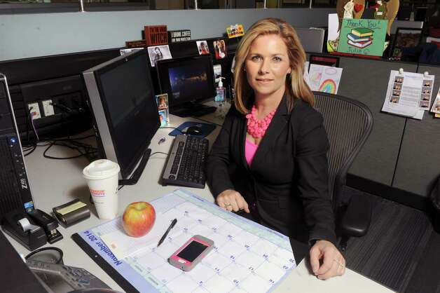 YNN's Julie Chapman at her desk on Thursday Nov. 6, 2014 in Albany, N.Y. (Michael P. Farrell/Times Union) Photo: Michael P. Farrell / 00029323A