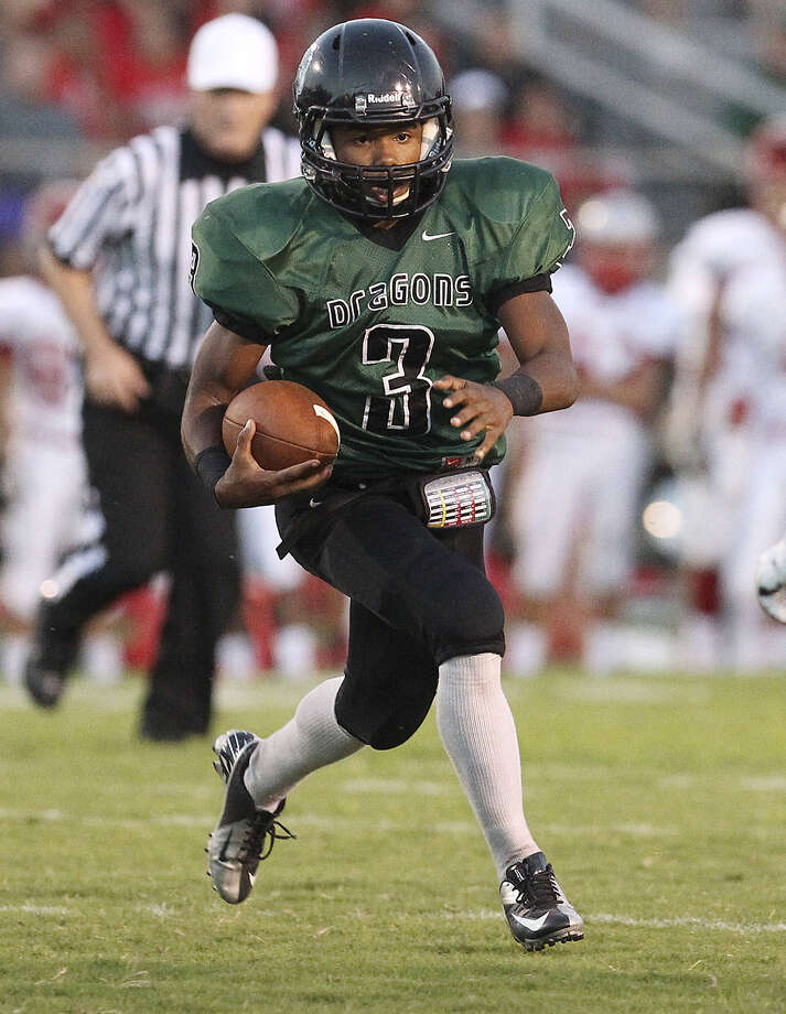 Southwest's Jon Cruz (03) scored two TDs and rushed for 236 yards on 35 carries in a 24-14 loss to Carroll on Friday night. Photo: San Antonio Express-News / ©2013 San Antonio Express-News