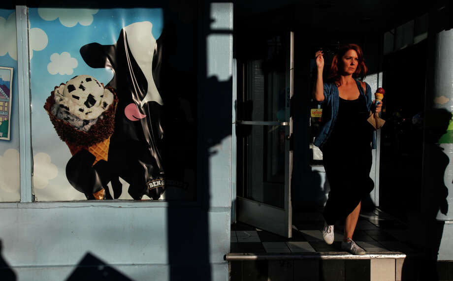 Suzanne Kissinger of San Francisco exits Ben & Jerry's ice cream shop on Haight Street on Nov. 8, 2014. Kissinger is a baker and prefers to use alcohol in lieu of sugar in her recipes. Photo: Leah Millis / The Chronicle / ONLINE_YES