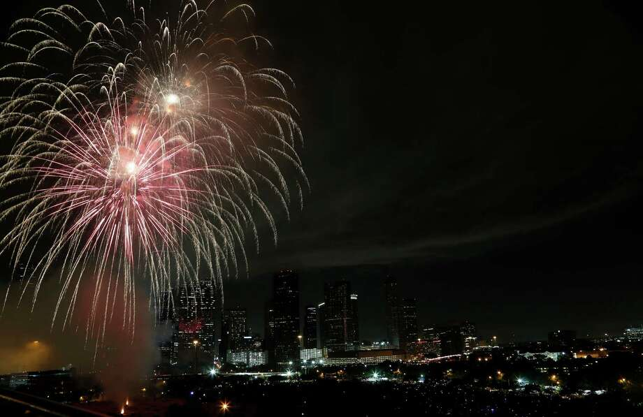 Fireworks light up the downtown skyline during the 2014 Southwest Airlines Freedom over Texas at Eleanor Tinsley and Sam Houston Parks, Friday, July 4, 2014, in Houston. ( Karen Warren / Houston Chronicle  ) Photo: Karen Warren, Staff / © 2014 Houston Chronicle