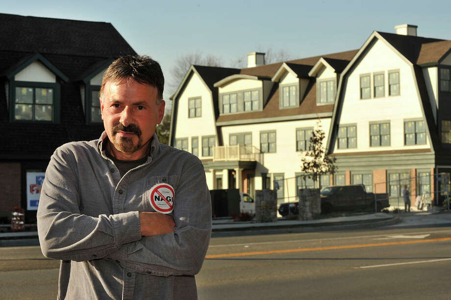 Community activist Paul Longo poses in front of an apartment complex and daycare facility along High Ridge Road developed by jewler Nagi Osta in Stamford, Conn., on Monday, Nov. 10, 2014. Some area community members are concerned about transient residents and increased vehicular traffic through their neighborhood that would be brought about because of the rental housing and daycare project developed by High Ridge Road jeweler Nagi Osta. Photo: Jason Rearick / Stamford Advocate