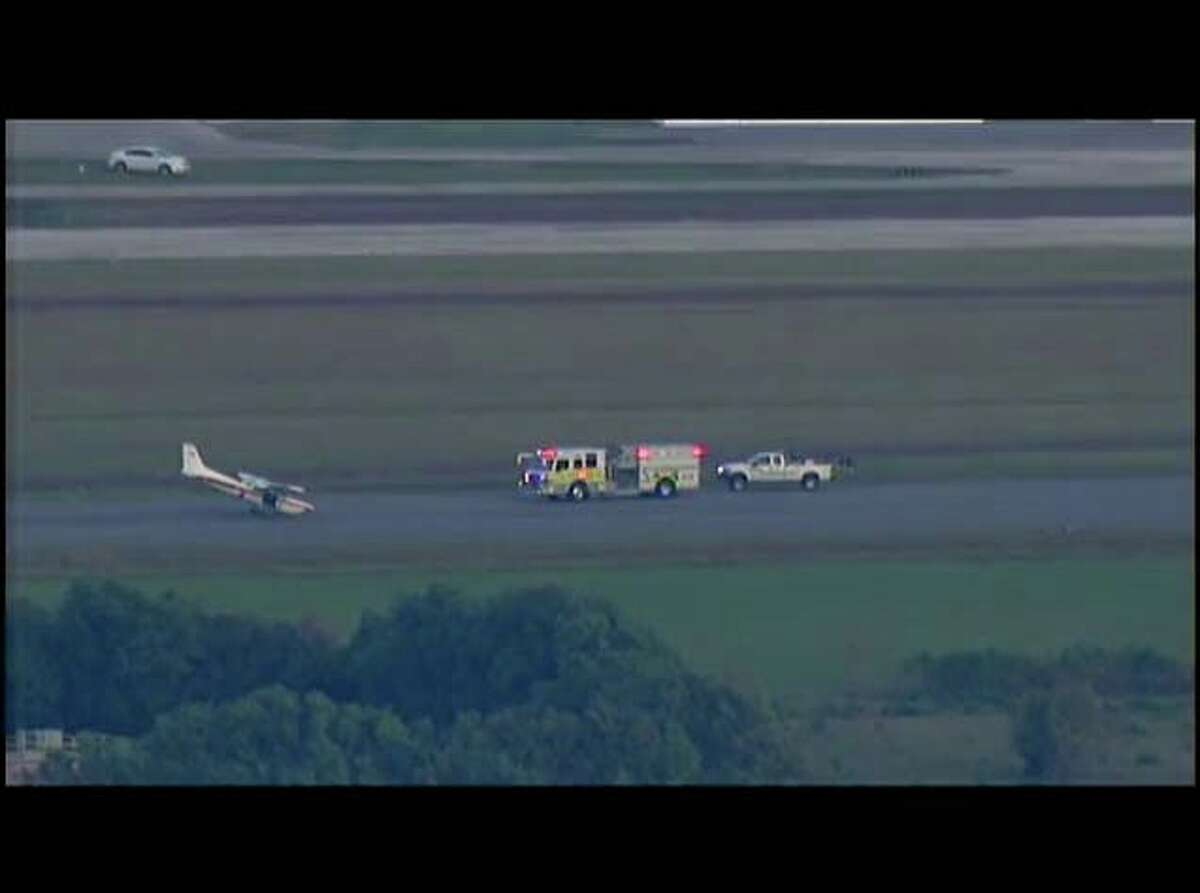 Small plane conducts an emergency landing at Hooks Airport.