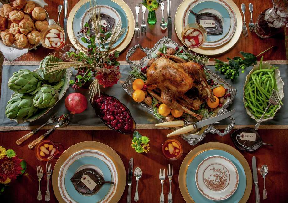 This Thanksgiving table uses soft blues, rich browns and gold to create a welcoming scene. Photo: John Everett / John Everett