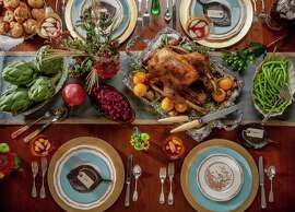 Welcome family and friends to your Thanksgiving feast with a tablescape that reflects your style. Photography by John Everett photos.