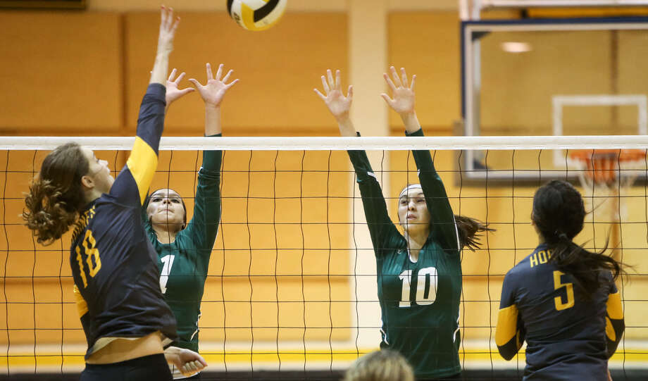 Southwest's Samantha Webb (10) and Lindsey Calderon try to block a shot by East Central's Lindsey Lubianski during their match in September. Photo: Marvin Pfeiffer / EN Communities / EN Communities 2014