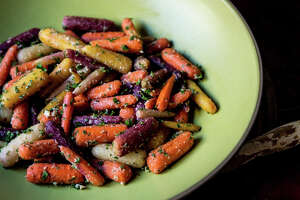 Sam Mogannam's roasted rainbow carrots with tahini dressing - Photo