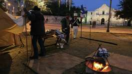 Members of the San Antonio Living History Association Nathan Weiss (from left), Grant Maloney and Adam Dominguez set up camp in Alamo Plaza on Dec. 6, 2013. The group reenacted the Battle of Bejar the next day.