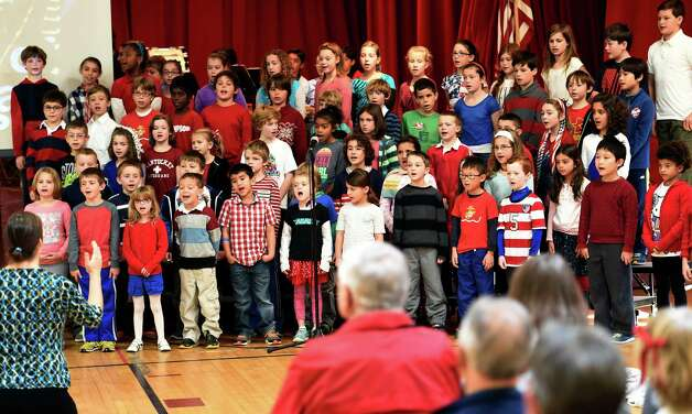 Grades 1-5 sing a tune during the Veterans Ceremony Monday morning Nov. 10, 2014 at Brown School in Schenectady, N.Y.       (Skip Dickstein/Times Union) Photo: SKIP DICKSTEIN / 00029415A