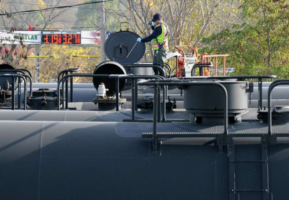 Empty oil tanker cars are checked before closing them up Monday afternoon, Nov. 10, 2014, at the Port of Albany in Albany, N.Y. (Will Waldron/Times Union) Photo: WW