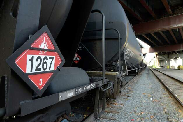 Oil tanker cars are parked under I-787 Monday afternoon, Nov. 10, 2014, near the Port of Albany in Albany, N.Y. (Will Waldron/Times Union) Photo: WW
