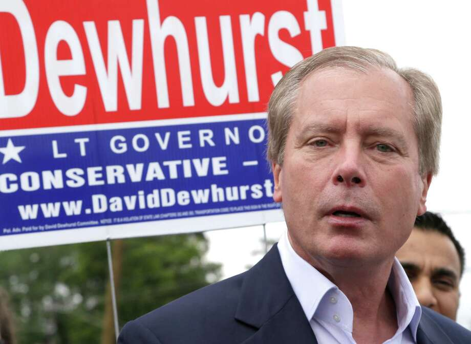 Texas Lt. Gov David Dewhurst faces the media at a polling place on election day Tuesday, May 27, 2014, in Houston. Dewhurst has been in a bitter Republican primary runoff against Dan Patrick. (AP Photo/Pat Sullivan) Photo: Pat Sullivan, STF / AP
