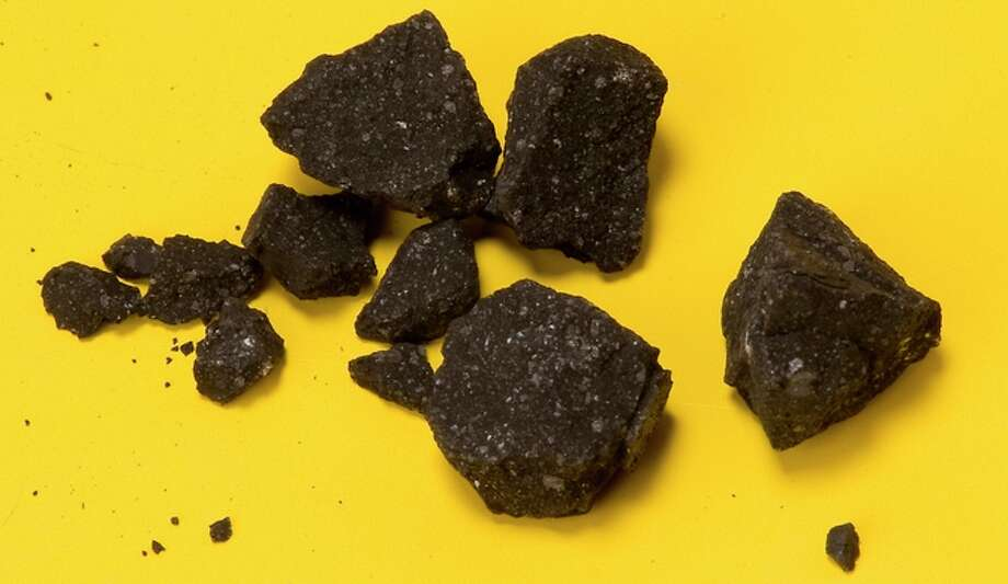 Fragments of the Sutter's Mill meteorite were collected by NASA Ames and SETI Institute astronomer Peter Jenniskens on April 24, 2012, two days after the fall. This was the second recovered find. Photo: Courtesy / NASA Ames/Eric James / ONLINE_YES