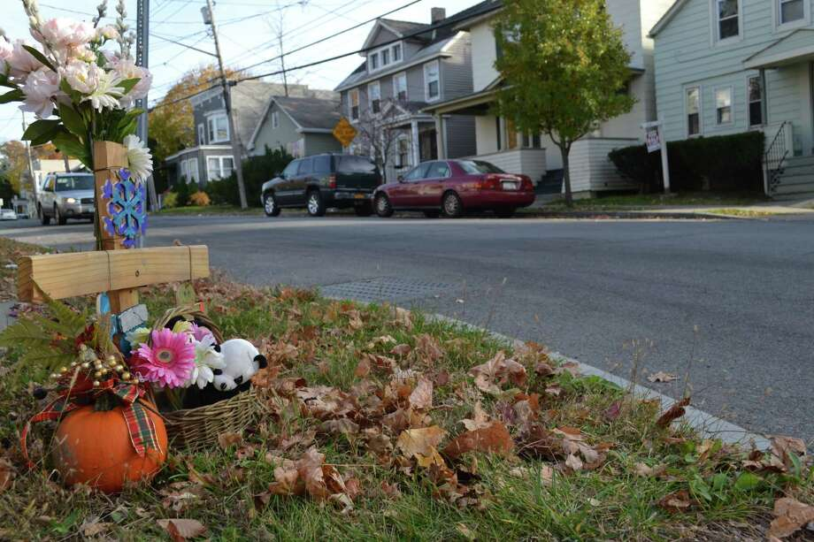 A memorial at the corner of Adams Street and Third Avenue Monday, Nov. 10, 2014, marking the intersection where Michelle Salisbury was killed. The 38-year-old East Greenbush resident was 31 weeks pregnant at the time. (Keshia Clukey/ Times Union)