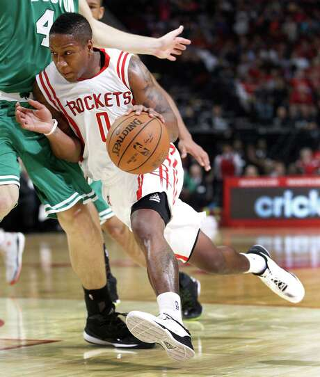 Rockets guard Isaiah Canaan, right, averages 9.7 points on 47.1 percent field-goal shooting. Photo: Karen Warren, Staff / © 2014 Houston Chronicle