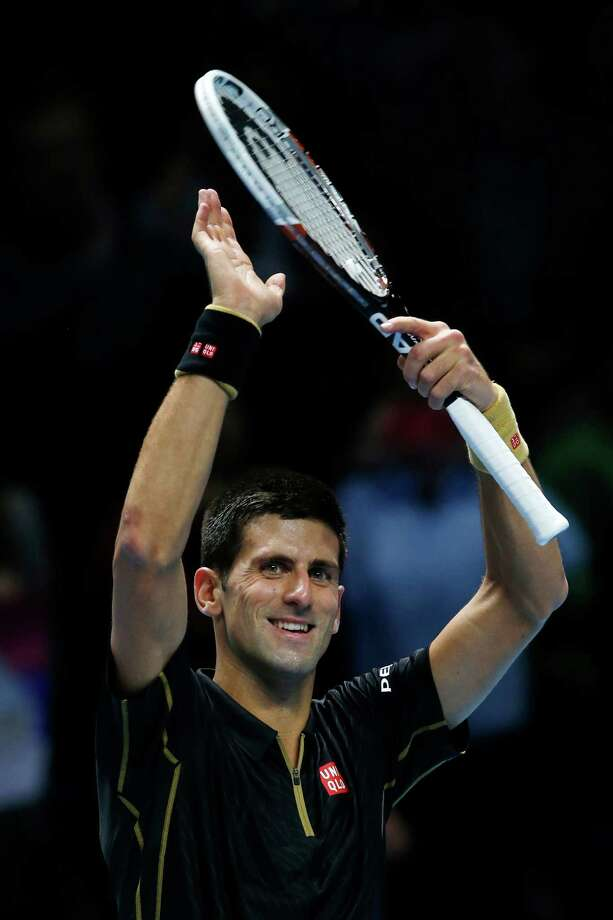 Serbia's Novak Djokovic celebrates winning against Croatia's Marin Cilic during their singles ATP World Tour tennis finals match at the O2 arena in London, Monday, Nov. 10, 2014. (AP Photo/Alastair Grant) ORG XMIT: LDA135 Photo: Alastair Grant / AP