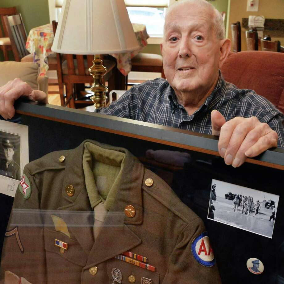 WWII veteran Theodore Tornesello with an historic shadow box displaying his US Army uniform Friday Nov. 7, 2014, at his home in Green Island, NY.  (John Carl D'Annibale / Times Union) Photo: John Carl D'Annibale / 00029341A