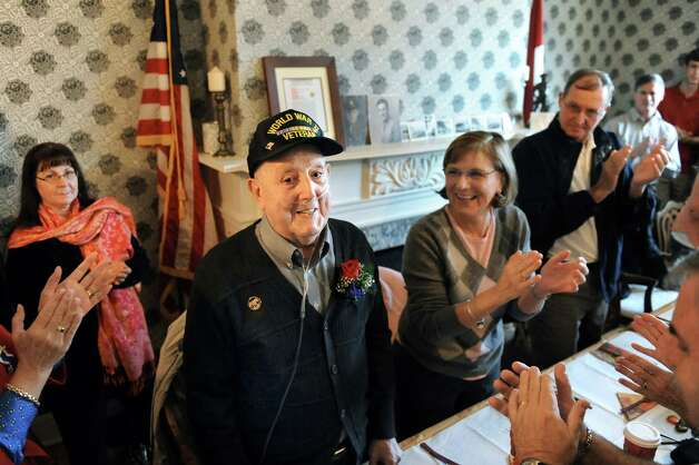 WWII veteran Ted Tornesello, 91, center, is recognized for his service during a Daughters of the American Revolution ceremony on Saturday, Nov. 8, 2014, at the Van Schaick Mansion House in Cohoes, N.Y. (Cindy Schultz / Times Union) Photo: Cindy Schultz / 00029410A