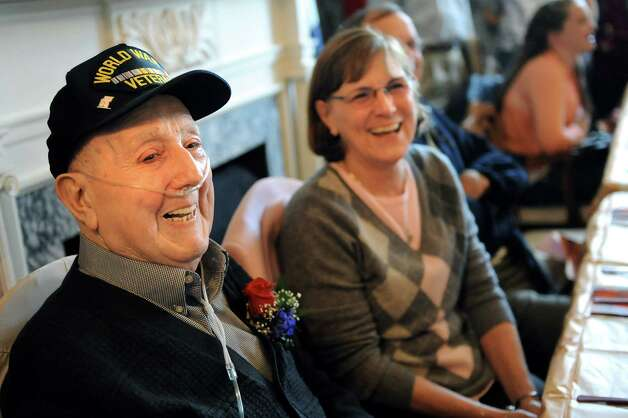 WWII veteran Ted Tornesello, left, is recognized during a Daughters of the American Revolution ceremony on Saturday, Nov. 8, 2014, at the Van Schaick Mansion House in Cohoes, N.Y. His daughter Re Getty, left, and other family members join him. (Cindy Schultz / Times Union) Photo: Cindy Schultz / 00029410A